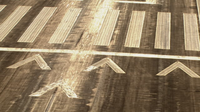 aircraft point of view of markings on landing strip tarmac. - campo d'aviazione video stock e b–roll