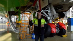 Aircraft service, view of the tail of the aircraft. Repair of an airplane wing white 4k.