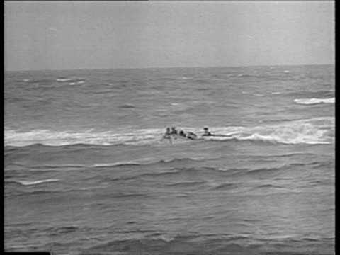 aircraft smoke of morro castle ship on fire / lifeboat with survivors nearing beach / bow of ship with smoke rising / smoke over burnt section. morro... - 1934 stock-videos und b-roll-filmmaterial