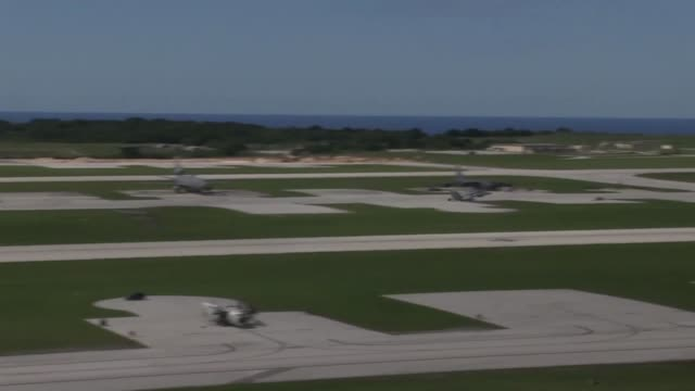 aircraft take off from andersen air force base, guam, september 18, 2014. the aircraft are taking off from andersen air force base as part of... - グアム点の映像素材/bロール