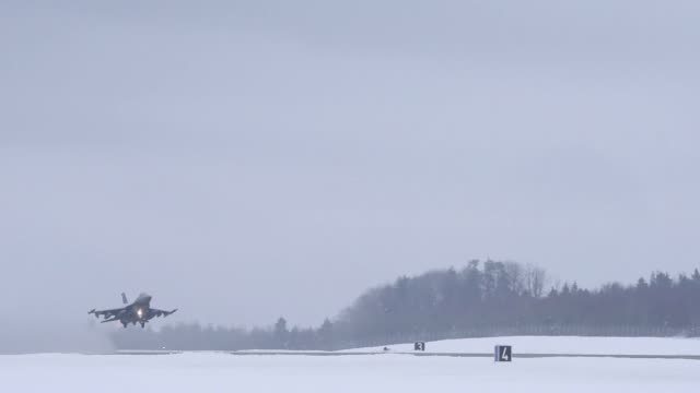 aircraft take off in snowy conditions from spangdahlem air base germany for deployment in portugal - afterburner stock videos and b-roll footage