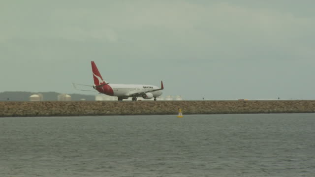 Aircraft taxiing on reclaimed land, Sydney Aiport, Australia