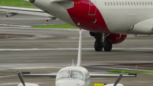aircraft taxiing on runway close-up - towing stock videos and b-roll footage
