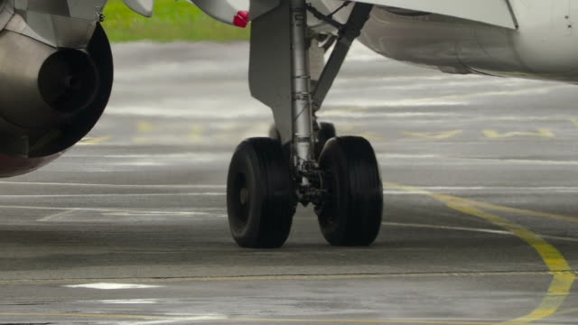 aircraft taxiing on runway close-up - wheel stock videos and b-roll footage