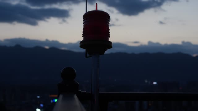 aircraft warning light on the top of buildings - control stock videos & royalty-free footage