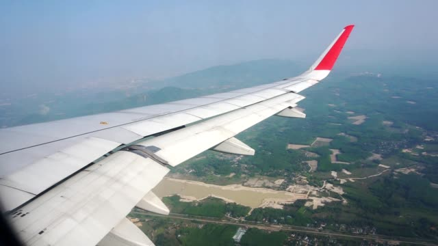 aircraft wing from an airplane window - aircraft wing stock videos & royalty-free footage
