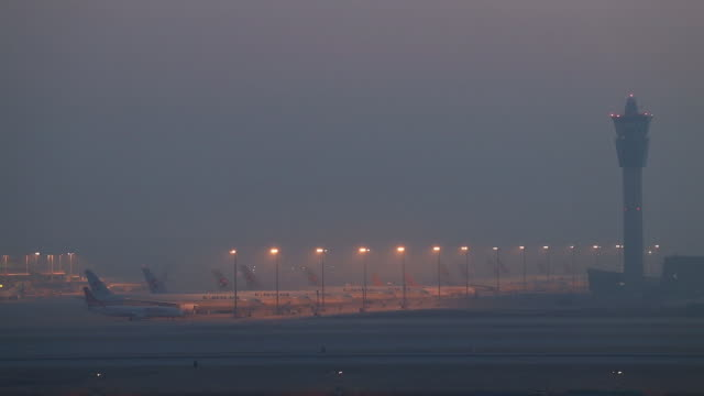 aircrafts parked at incheon international airport and temperature checks in incheon south korea on monday march 9 2020 - monday morning stock videos & royalty-free footage