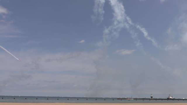 aircrafts perform during a real-time rehearsal for the 59th chicago air and water show over north avenue beach in chicago, united states on august... - chicago air and water show stock videos & royalty-free footage