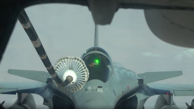 aircrew from 908th expeditionary aerial refueling squadron use a kc10 extender to refuel us f15 strike eagles f35a lightning ii's and french air... - mcdonnell douglas f 15 eagle stock videos & royalty-free footage