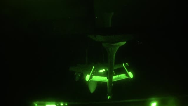 aircrew from 908th expeditionary aerial refueling squadron use a kc10 extender to refuel us f15 strike eagles at night at an undisclosed location 22... - above stock videos & royalty-free footage