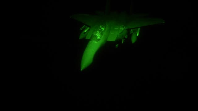 aircrew from 908th expeditionary aerial refueling squadron use a kc10 extender to refuel us f15 strike eagles at night at an undisclosed location 22... - night vision stock videos and b-roll footage