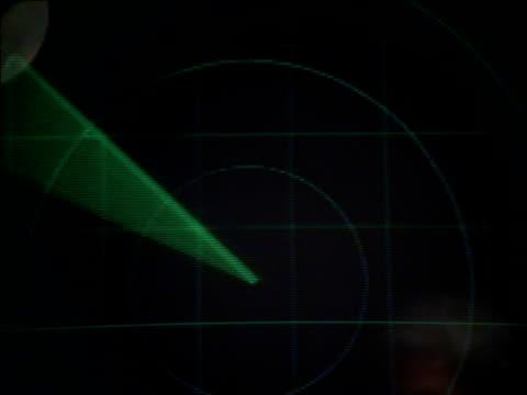 aircrew member reflected in radar screen as green tracking beam circles clockwise - radar stock videos & royalty-free footage