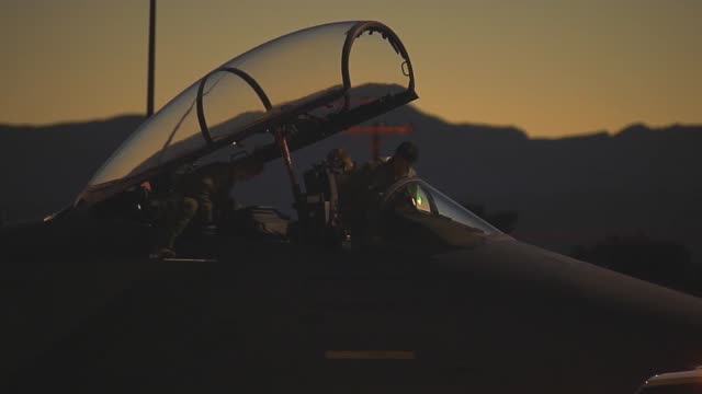 Aircrew members in an F15E prepare for takeoff during Red Flag 143 Jul 21 2014