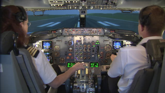 Aircrew training in Boeing 737 400 simulator, female captain and male FO performing take-off / Johannesburg, Gauteng, South Africa