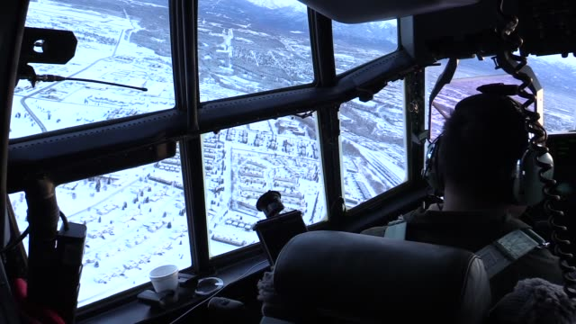 aircrew with 211th rescue squadron in hc-130j combat king ii hercules conduct an aerial survey to assess the damage caused by the 7.0-magnitude... - homer alaska stock videos & royalty-free footage