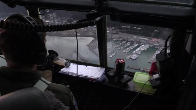 aircrew with 211th rescue squadron in hc-130j combat king ii hercules conduct an aerial survey to assess the damage caused by the 7.0-magnitude... - geology stock videos & royalty-free footage