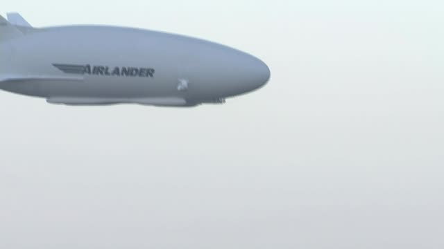 Pilot talks about crash T17081637 / 1782016 Bedfordshire EXT Various of Airlander airship in flight during previous test flight