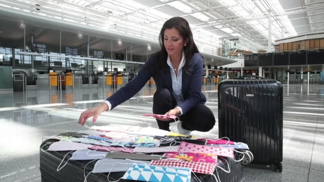 airline flight attendant and dirndl designer birgit backeler lays out her handmade protective face masks at munich international airport... - design professional stock videos & royalty-free footage