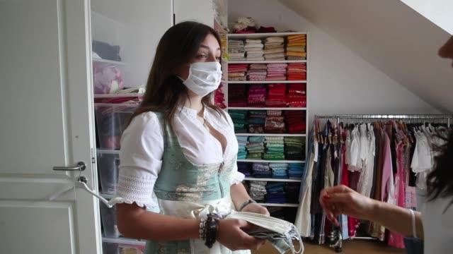 airline flight attendant and dirndl designer birgit backeler sews protective face masks in her dirndl workshop during the novel coronavirus crisis on... - arts culture and entertainment stock videos & royalty-free footage
