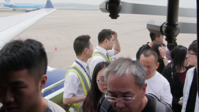 airline passengers aboard plane in china - aboard stock videos & royalty-free footage