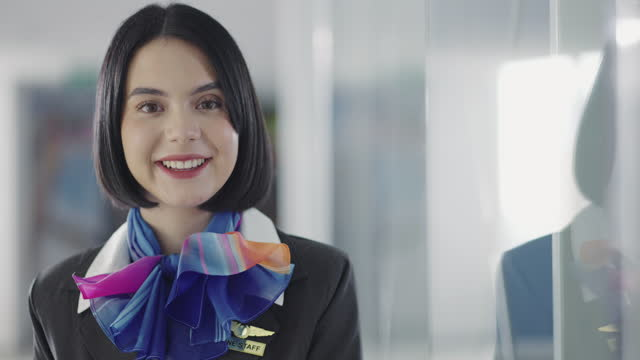airline stewardess in airport lounge - crew stock videos & royalty-free footage