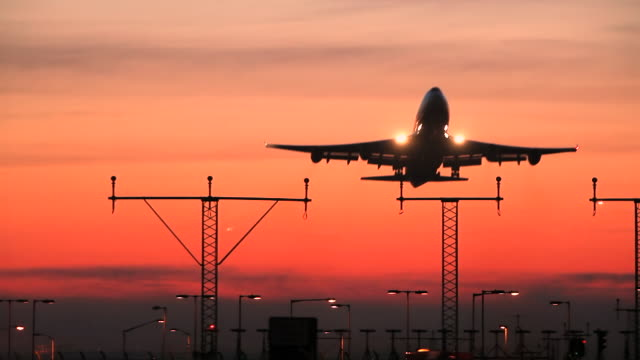 stockvideo's en b-roll-footage met airliner sunset departure - taking off