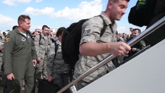 airmen at dyess load onto commercial plane land at raf fairford and unload cargo - raf fairford stock videos and b-roll footage