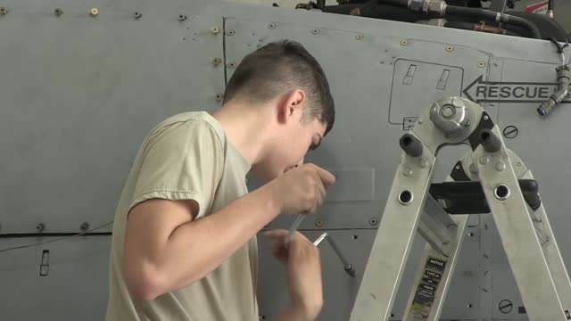 Airmen conducting maintenance on the A10C Thunderbolt II at Davis Monthan Air Force Base Arizona