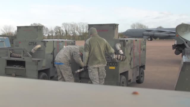 airmen from the 5th logistics readiness squadron conduct support operations at raf fairford, england, jan. 16, 2018. activities include transporting... - 禁煙マーク点の映像素材/bロール