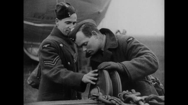 b/w raf airmen inspecting and working with tethering system of helium barrage balloons / united kingdom - raf stock videos & royalty-free footage