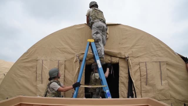 airmen of the ohio air national guard 200th red horse squadron conduct a multiday field training exercise at camp perry oh incorporating construction... - national guard stock videos and b-roll footage