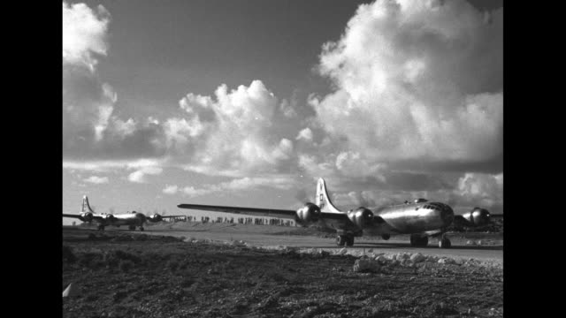 """airmen with b-29 airplane labeled """"dauntless dotty"""" / vs b-29 superfortresses on tarmac / montage b-29s take off from saipan island, with blue sky... - b29 stock videos & royalty-free footage"""