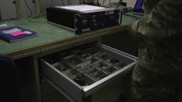 airmen with operations support squadron maintaining radar airfield and weather systems at raf lakenheath united kingdom - safety harness stock videos & royalty-free footage