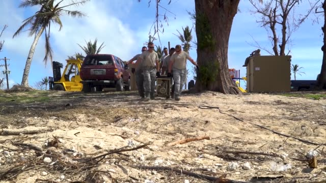 airmen with the 36th civil engineer squadron, assigned to andersen air force base, guam, set up a new clean water distribution site at pakpak beach,... - グアム点の映像素材/bロール