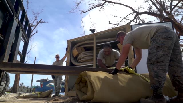 airmen with the 36th civil engineer squadron assigned to andersen air force base guam set up a new clean water distribution site at pakpak beach san... - bladder stock videos and b-roll footage