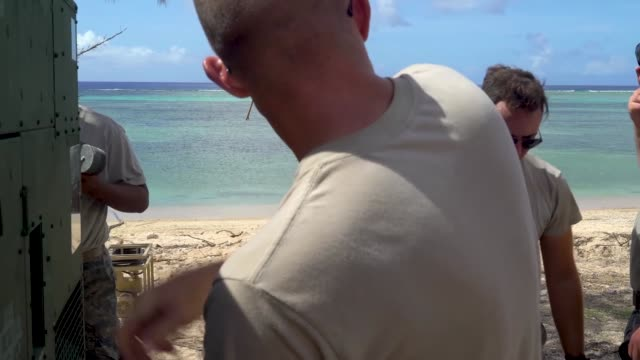 airmen with the 36th civil engineer squadron, assigned to andersen air force base, guam, set up a new clean water distribution site at pakpak beach,... - guam stock videos & royalty-free footage