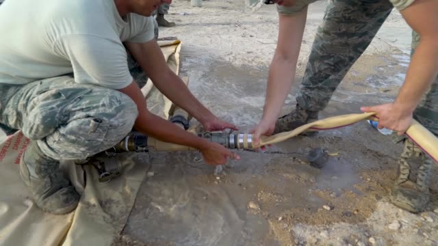 airmen with the 36th civil engineer squadron, assigned to andersen air force base, guam, set up a new clean water distribution site at pakpak beach,... - レリーフ点の映像素材/bロール