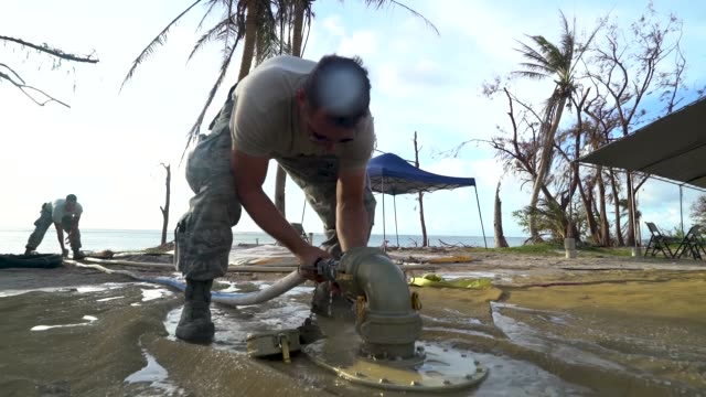 airmen with the 36th civil engineer squadron, assigned to andersen air force base, guam, set up a new clean water distribution site at pakpak beach,... - guam video stock e b–roll
