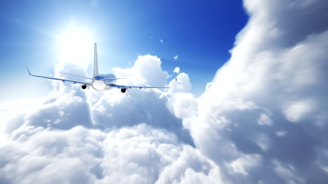 airplane above the clouds - perfect loop - mid air stock videos & royalty-free footage