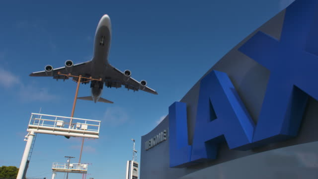 airplane approaching lax - lax airport stock videos & royalty-free footage