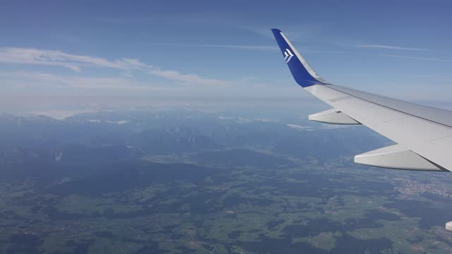 airplane approaching munich international airport on august 09, 2021 in munich, germany. - tranquil scene stock videos & royalty-free footage