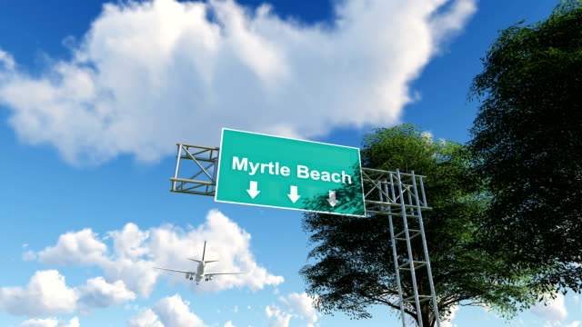 airplane arriving to myrtle beach airport to usa - road sign stock videos & royalty-free footage
