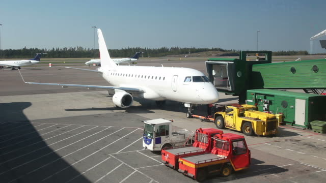 Airplane at Airport with groundcrew