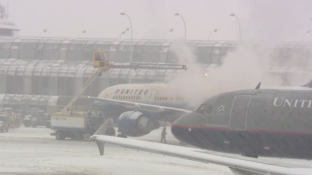 airplane being deiced at airport at chicago o'hare airport on december 09 2013 in chicago illinois - o'hare airport stock videos & royalty-free footage
