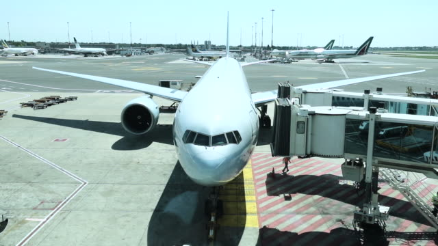 airplane boarding before departure - stationary stock videos & royalty-free footage