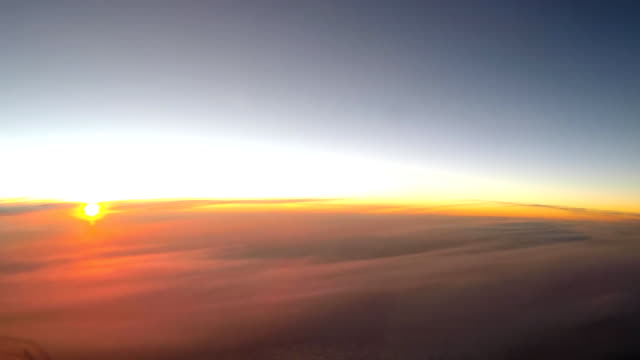 airplane cockpit view timelapse sunrise clouds - pilot stock videos & royalty-free footage
