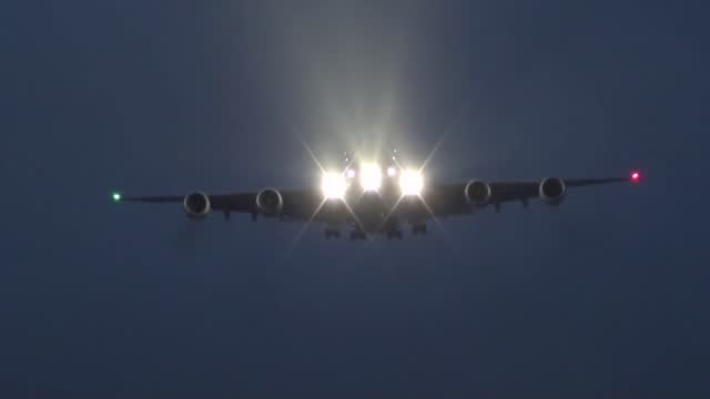 """airplane enthusiast tom pipe filmed the smooth landing of a malaysia airlines a380 airbus on a dark and rainy december evening. """"stood at the end of... - smooth stock videos & royalty-free footage"""