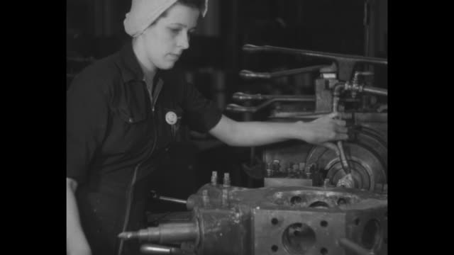 airplane factory with engine being transported overhead / female worker operating machinery / woman in welding mask / woman with airplane equipment /... - metal worker stock videos & royalty-free footage