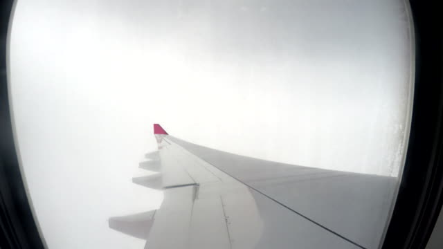 airplane flying above clouds - cumulonimbus stock videos & royalty-free footage
