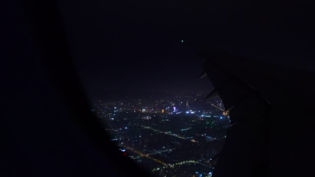 airplane flying above down town - hangzhou stock videos & royalty-free footage
